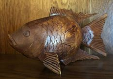 A carved wooden fish