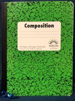 A green-and-black composition notebook