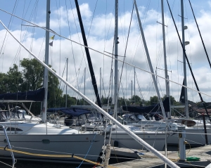 Several docked sailboats, emphasizing the angles of their masts and rigging