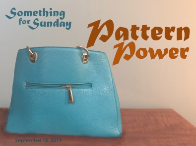A blue leather purse that resembles a face, with grommet eyes and a zipper mouth. Text: Something for Sunday; September 15, 2019; Pwttern Power