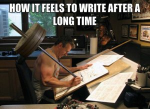 Strong man struggling to write with a bar that has many heavy weights on the other end. Text: How it feels to write after a long time