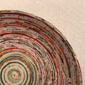 Closeup of a bowl made from concentric rings of many different colors