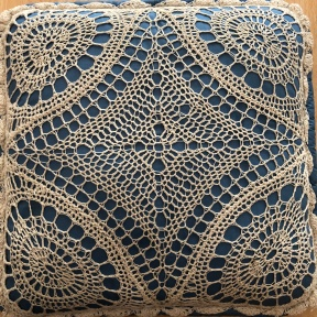 An elaborate crochet pattern in the cover of a pillow