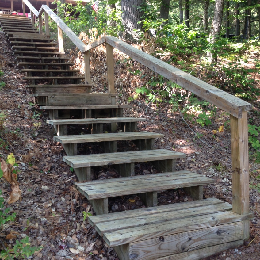 Rough wooden stairs with a railing