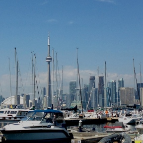 A view of Toronto from across the bay, looking like a forest of vertical skyscrapers and sailboat masts