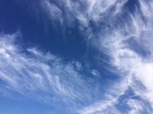 White clouds swirled against a vivid blue sky