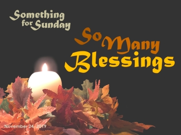 A burning candle surrounded by vividly colored autumn leaves. Text: Something for Sunday; November 24, 2019; So Many Blessings