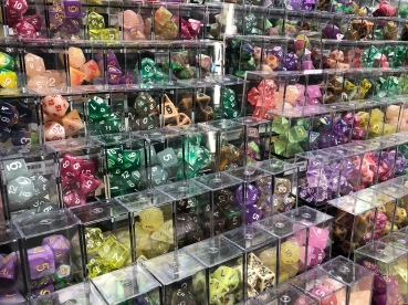 A store display with many dozens of sets of polyhderal dice, suitable for role-playing games